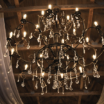 Sparkling crystal chandelier hanging in the Naimoli Estate barn which is perfect for adding beautiful atmosphere to Kentucky or destination weddings